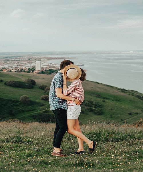 couple hugging kissing hill sea cheap date ideas